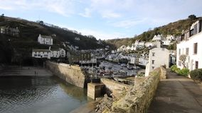 Polperro harbour Cornwall England UK smooth professional video pan with harbour buildings and village streets stock footage