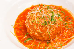 Polpettone al Pomodoro. A very large Italian meatball bathed in rich pomodoro sauce, garnished with parmesan and parsley Stock Photos