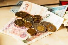 Polscy pieniędzy banknoty, monety i Obraz Royalty Free