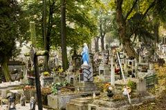 Polsk kyrkogård Jesus med korset Arkivbild