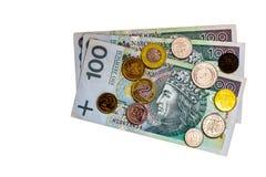 Polsk valuta 100 zlotys- och groszymynt på den vita bästa sikten
