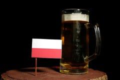 Polska flaga z piwnym kubkiem na czerni Fotografia Stock