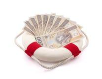 Polska pengar i lifebuoy Fotografering för Bildbyråer