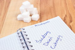 Polski wpisowy Światowy cukrzyca dzień w notatnika i cukieru sześcianach, symbol cukrzyk obrazy royalty free
