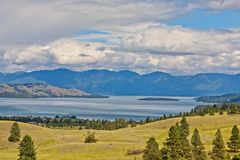 Polson, Montana with Flathead Lake in the background. A scenic view of Flathead Lake from Polson,Montana with clouds over the mountains in the background Stock Image