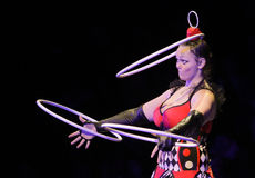 POLTAVA, UKRAINE - DECEMBER 19, 2016: Gymnast turns 3 hoops Hula hoops during the performance of circus show Kobzov royalty free stock photography