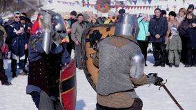 Poltava, Ukraine, Jan 2017: Medieval tournament and competition between two strong knights with steel swords. Medieval tournament and competition between two