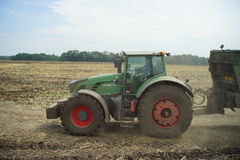 POLTAVA, UKRAINE - 29 JULY 2015: Tractor spreading manure on fields. This procedure allows to collect two harvests a year. Stock Photography