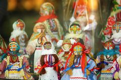 Motankas - traditional ukrainian dolls on display in toy shop window. Symbol of fertility and household guardians,they have no fac stock photography