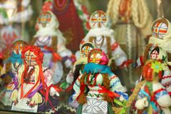Motankas - traditional ukrainian dolls on display in toy shop window. Symbol of fertility and household guardians,they have no fac royalty free stock images