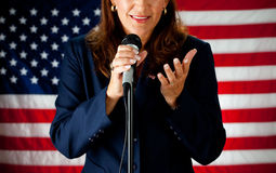 Político: Político alegre Talking en el micrófono Imagenes de archivo