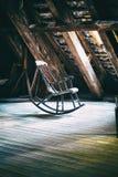 A poltrona de balanço no assoalho do sótão da torre redonda em Copenhaga Imagens de Stock