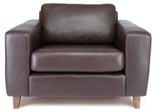 Poltrona de couro marrom Comfy em um fundo branco Imagens de Stock Royalty Free