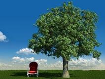 Poltrona ed albero nei prati Immagine Stock
