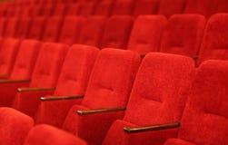 Poltrone del teatro in una riga Fotografia Stock