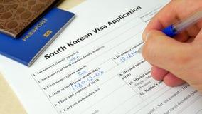 Poludniowo-koreański wniosku wizowego forma z paszportem i piórem zdjęcie wideo
