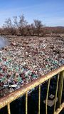 Polution with plastic waste on a river Stock Photo