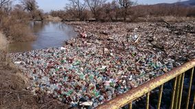Polution with plastic waste on a river Royalty Free Stock Photos