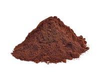 Polvere del caffè isolata sui precedenti bianchi Immagini Stock