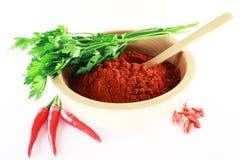 Polvere della paprica con il peperoncino rosso ed il prezzemolo Fotografia Stock Libera da Diritti