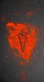 Polvere di peperoncino rosso con il simbolo Fotografie Stock