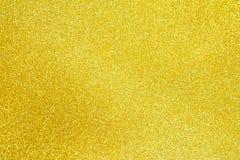 Polvilhe a poeira de ouro do brilho textured foto de stock