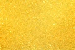 Polvilhe a poeira de ouro do brilho textured fotografia de stock