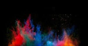 Polvo colorido lanzado Foto de archivo libre de regalías