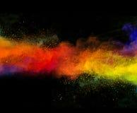 Polvo colorido lanzado en fondo negro fotografía de archivo libre de regalías
