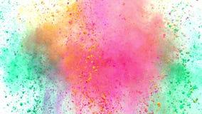 Polvo colorido que estalla en el fondo blanco en la c?mara lenta estupenda metrajes