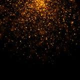 Polvo de estrellas del bokeh del oro que brilla Fotos de archivo