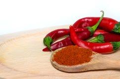 Polvo de las pimientas y de los salchichones de chile rojo Foto de archivo libre de regalías