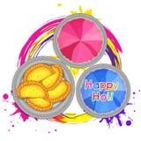 Polvo del color con los dulces para la celebración de Holi Imágenes de archivo libres de regalías