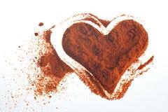 polvo del rojo del corazón imagenes de archivo