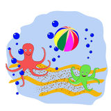 Polvo dois que joga a bola na parte inferior do mar Foto de Stock