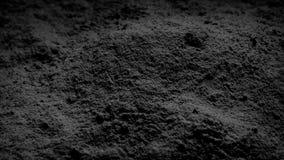 Polvo negro que gira