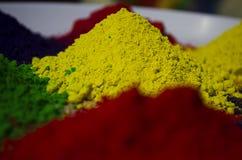 Polvos coloridos de Holi Foto de archivo libre de regalías
