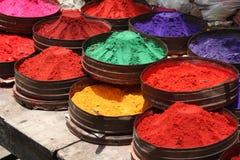 Polvos del color en un departamento Foto de archivo libre de regalías