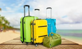 Poly-carbonate suitcases. Pocket rolls booking white travel red Royalty Free Stock Photography