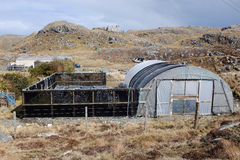 Poly tunnel garden. A poly tunnel on moorland with fence and enclosure area Royalty Free Stock Photos