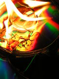 Polychrome Burn. A few cds on fire royalty free stock photos