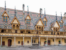 Polychrome roof of the Hospices de Beaune. Royalty Free Stock Photography