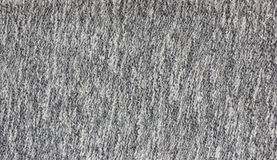 Polyeste gray-white. Light gray-white polyester textiles boucle background Stock Images