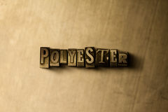 POLYESTER - close-up of grungy vintage typeset word on metal backdrop. Royalty free stock illustration.  Can be used for online banner ads and direct mail Royalty Free Stock Photos