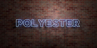POLYESTER - fluorescent Neon tube Sign on brickwork - Front view - 3D rendered royalty free stock picture. Can be used for online banner ads and direct mailers Royalty Free Stock Photos