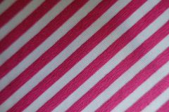 Polyester in pink and white with diagonal stripes. From above Stock Photo