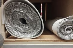 Polyethylene Insulation isolation foam with aluminum foil in rolls in store royalty free stock image