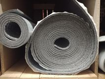 Polyethylene Insulation isolation foam with aluminum foil in rolls in store. Polyethylene Insulation isolation foam with aluminum foil in rolls stock photography