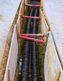 Polyethylene pipes in the excavation of the road construction site. Thick polyethylene pipes in the excavation of the road construction site for the installation Royalty Free Stock Image