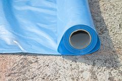 Polyethylene protection vapour barrier to restrict the passage o. F vapour from the hot part of the structure to the cold part of roof and wall and protect it Royalty Free Stock Photos